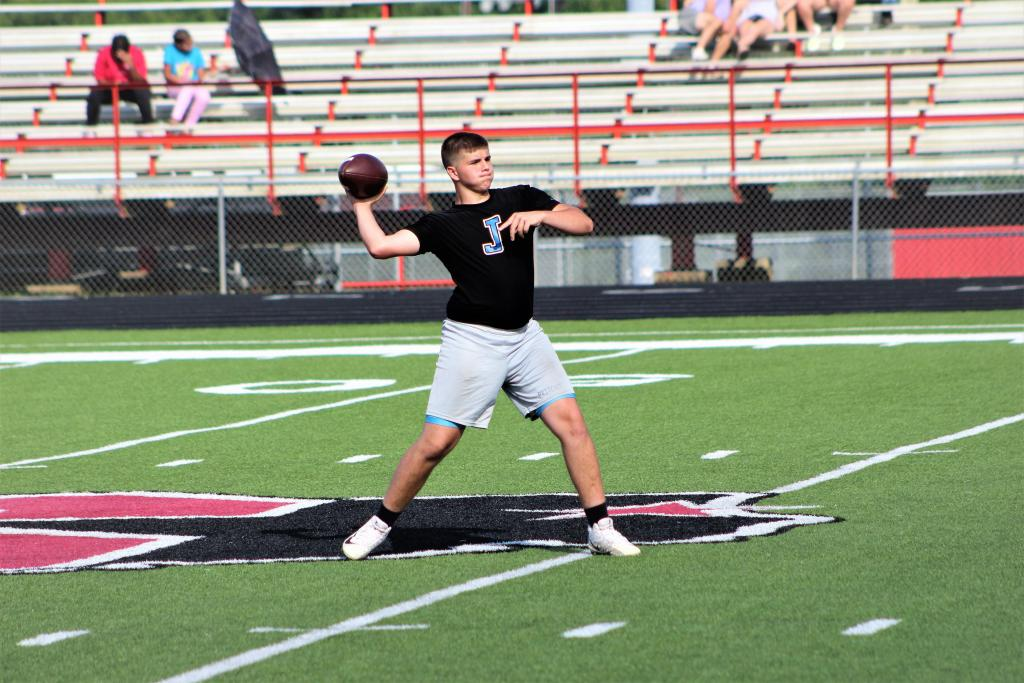 """Chandler Prichett of Joaquin delivers a deep ball down the field to """"Boogie"""" Lane in 7-on-7 football drills. (Photo by Colton Bragg, Light and Champion)"""