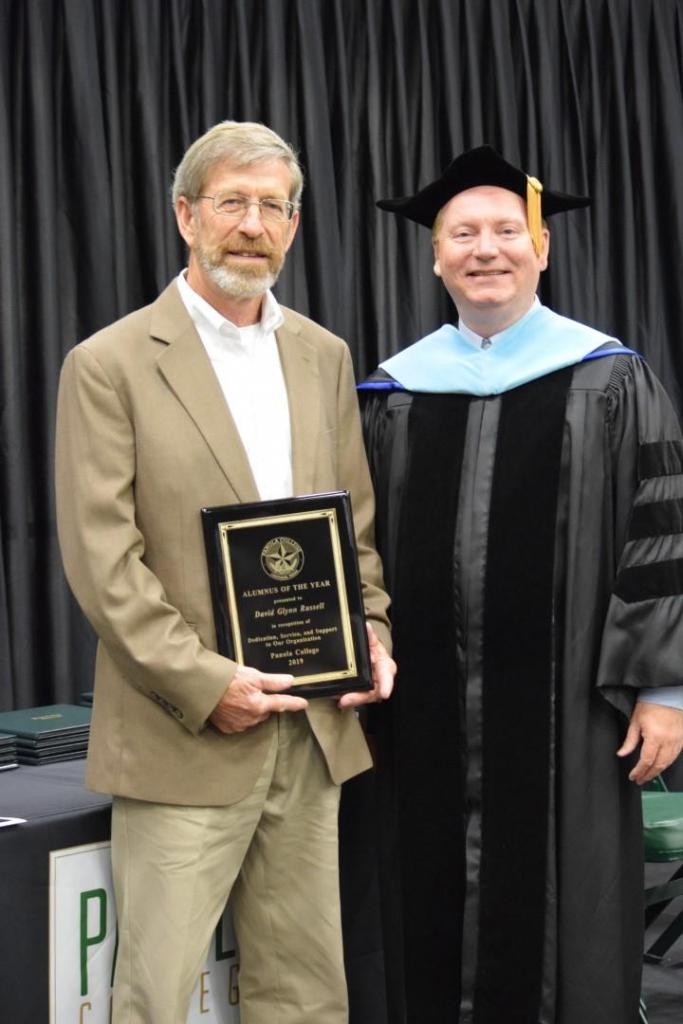 Dr. Greg Powell poses with the 2019 award for Panola College Alumnus of the Year, Mr. David Glynn Russell.