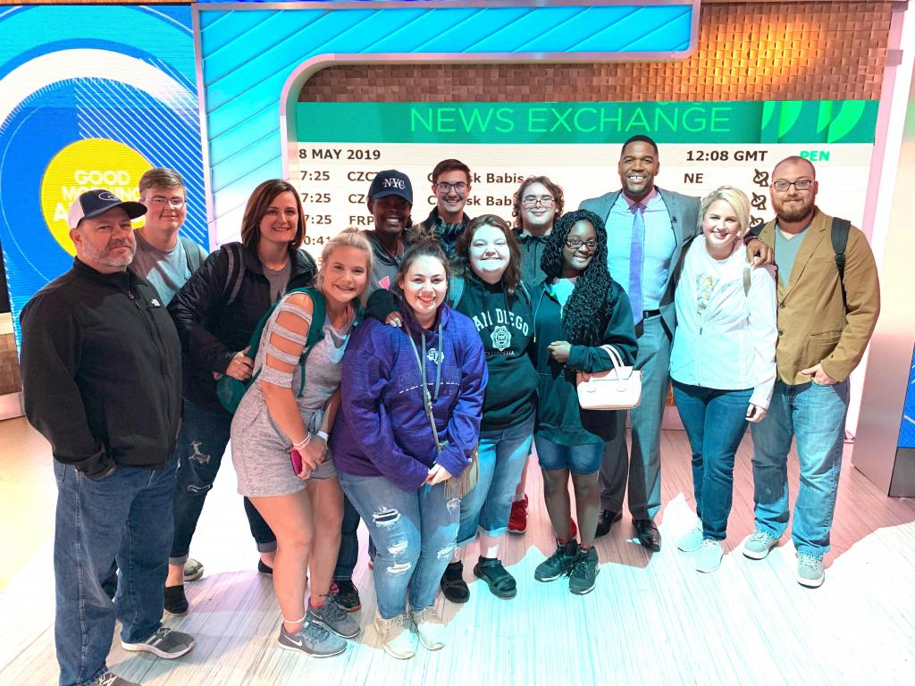 "Michael Strahan of ""Good Morning America,"" poses with Timpson Band senior group on May 8."