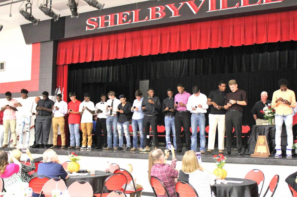 The looks on the faces of the Shelbyville Dragons say that it doesn't get much better than a State Championship ring. (Photo by Taylor Bragg, Freelance Photographer)